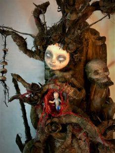 close up mixed media assemblage dark art sculpture monster woman open womb