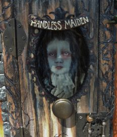 close-up of the front door of shadow box cabinet looking in to see portrait of the Beloved