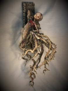 wounded woman bleeding heart mixed media assemblage sculpture made of porcelain, cloth mache & wood