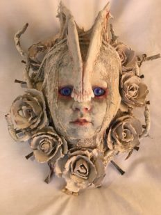 repainted baby doll head bone and white rose headdress red-rimmed blue eyes macabre