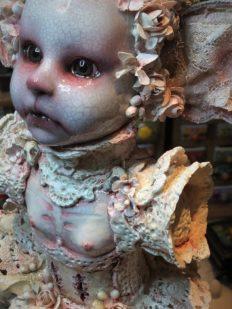 face closeup of mixed media assemblage porcelain doll dark art