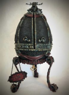 vintage viewing egg repainted gothic dark colors music box on a stand