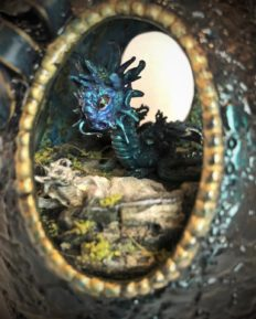 peek through oval window at green and blue fantasy dragon creature above lifeless maiden