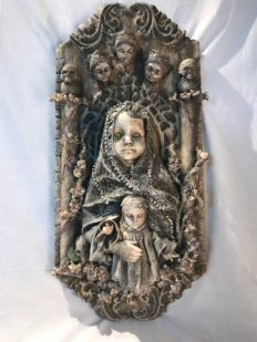 mixed media assemblage plaque repainted sainted robed baby doll holding a baby with the three fates above her
