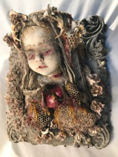 mixed media assemblage plaque blindfolded painted porcelain doll with bone and honeycomb