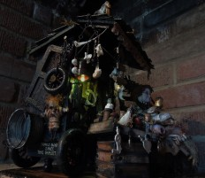 the back of Mixed Media Taxidermy Nightlight Assemblage of peddlars cart filled with bones, potions and spells