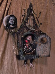 hand sculpted mini house with bird feet. Behind the door brave VasaLisa looks out for BabaYaga folk art mixed media assemblage